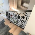 Wrought iron railing with leaves and flowers motif in a Sydney kitchen company showroom in Willoughby
